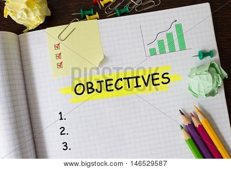 Notebook with Tools and Notes about Objectives concept