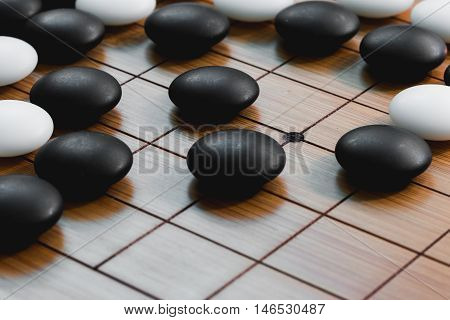 Go game or Weiqi (Chinese board game)