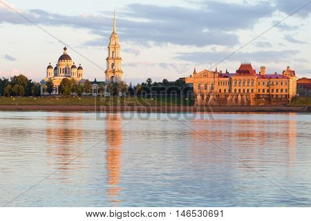 View of the Spaso-Preobrazhensky Cathedral and the corn exchange building on the Volga embankment, july evening. Rybinsk, Russia
