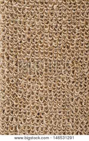 Rough flax fabric with loops. Natural flax fibres are processed to a coarse fabric, used for massage straps and gloves. Solid yarn with brown ochre color. Isolated macro photo close up.
