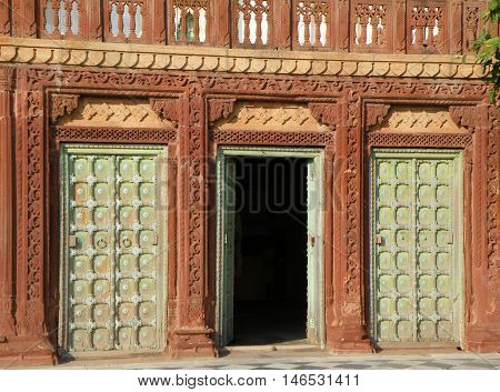 Indian Traditional Style Building and Doorway in Vintage Brown and Green Color, Rajasthan, India