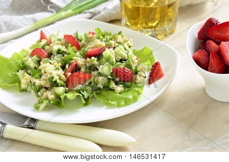 Tabbouleh with strawberries bulgur and vegetables, selective focus