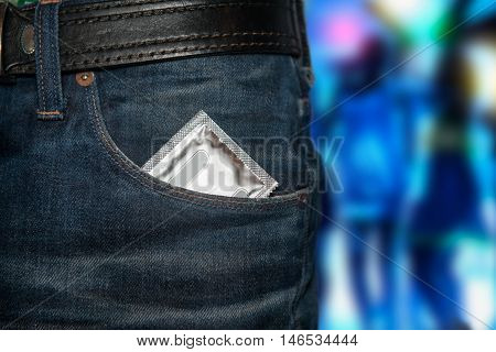 Concept photo of safety sex on date. Condom at the pocket.
