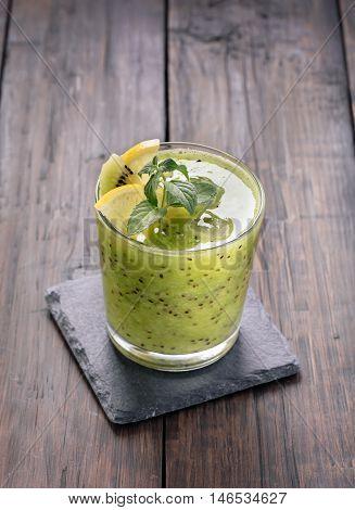 Morning green smoothie with kiwi and lemon.Toned