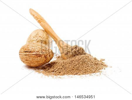 Nutmegs with spoon isolated on white background
