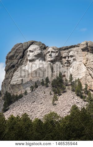 Vertical Side view of Mount Rushmore with sunlight