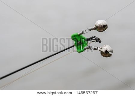 The bell on the fishing rod. spinning equipment.
