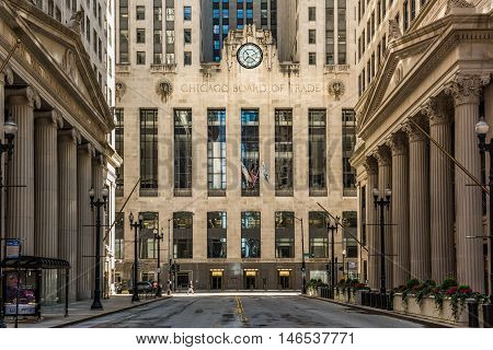 Chicago, USA - May 30, 2016: Symmetrical art deco building of Board of Trade along La Salle street in Illinois