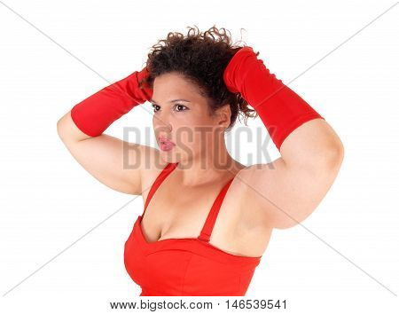 A beautiful closeup image of a lovely woman in a red dress and cloves whit her hands on her head isolated for white background.