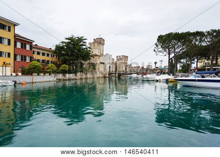 Sirmione Italy - May 09 2016: Castle of Scaligero in the bay the main landmark of Sirmione town