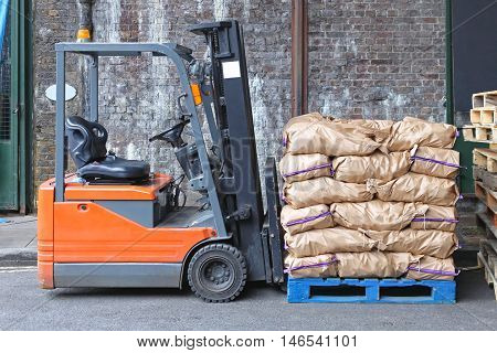 Forklift With Sacks of Potato at Pallet
