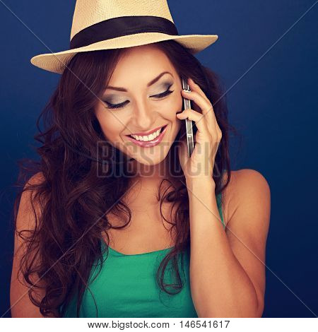 Happy Beautiful Makeup Woman Talking On Mobile Phone In Summer Hat And Looking Down On Bright Blue B