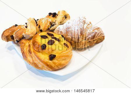 Brioches on white plateitalian breakfast white background.