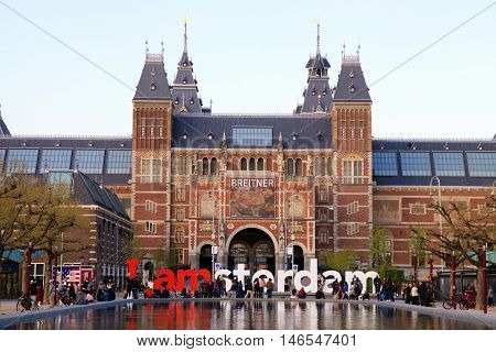 AMSTERDAM, NETHERLANDS - MAY 4, 2016: The Rijksmuseum Amsterdam museum area with pool and the words IAMSTERDAM in Amsterdam, The Netherlands.