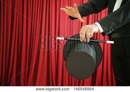 Magician Performing With Top Hat And Magic Wand