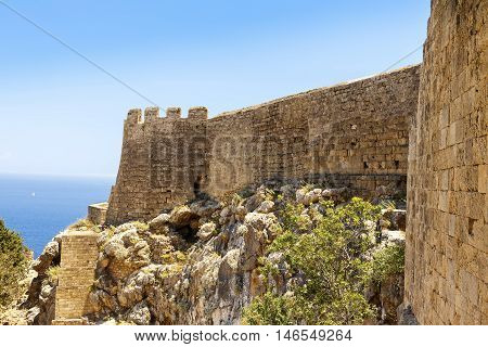 Popular tourist attraction the archaeological site of the acropolis of Lindos, a natural citadel on the island of Rhodes.
