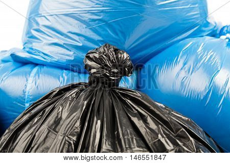 Black and blue garbage bags as background
