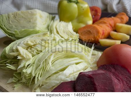 fresh vegetables chopped chopped cabbage yellow peppers orange carrots red tomatoes potatoes beets for soup stew salad