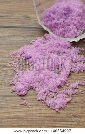 Bath salt isolated against a wooden background