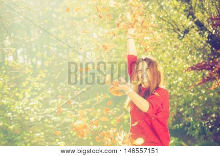Lady Playing With Leaves.
