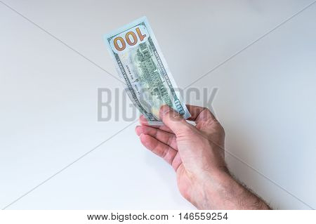 Man Giving One Hundred US Dollar Banknote