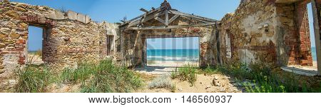 Panoramic View of Desolated Structure by the Sea