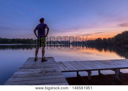 Man Ovelooking Lake While Sad