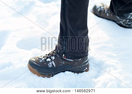 Feet in boots on the snow. footprints in the snow. The texture of the snow with footprints.