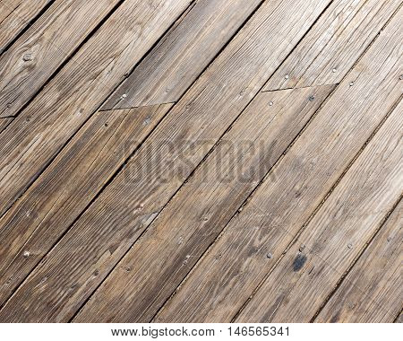 Diagonal weathered wooden plank background from boardwalk
