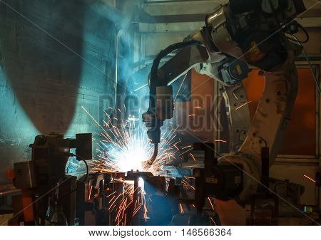 The Auto parts robots welding in a car factory.