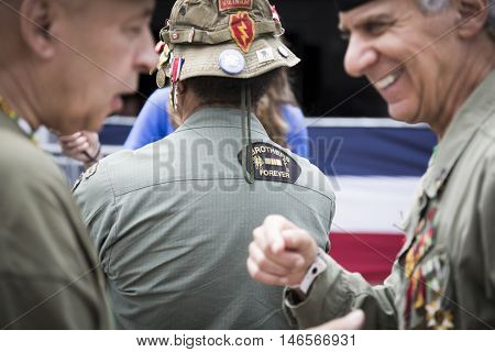 NEW YORK MAY 30 2016: US veterans in their uniforms with medals attend the annual Memorial Day Observance service on the Intrepid Sea, Air & Space Museum in Manhattan during Fleet Week NY 2016.