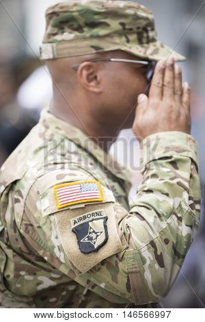 NEW YORK MAY 30 2016: Close up of a member of the U.S. Army Airborne Division saluting at the Memorial Day Observance service on the Intrepid Sea, Air & Space Museum.