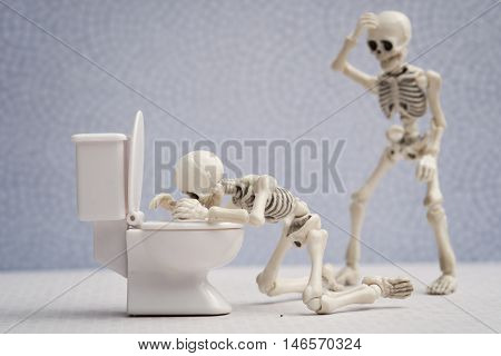 A skeleton got sick and vomiting in bathroom
