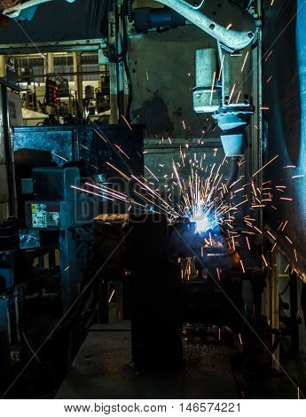 The movement of the welding robot in a car factory