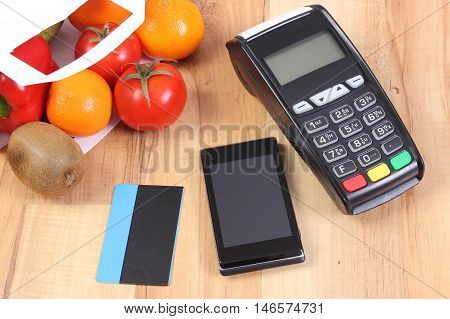 Payment Terminal, Mobile Phone With Nfc Technology And Credit Card, Fruits And Vegetables, Cashless