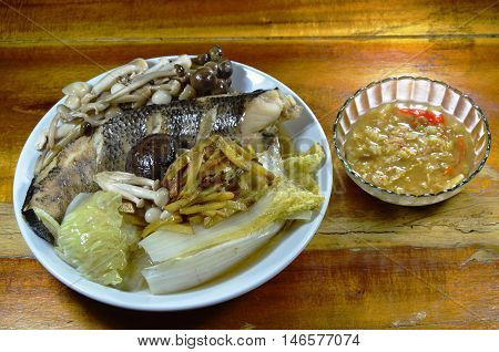 steamed striped snake head fish with mushroom and slice ginger dipping spicy soy bean sauce