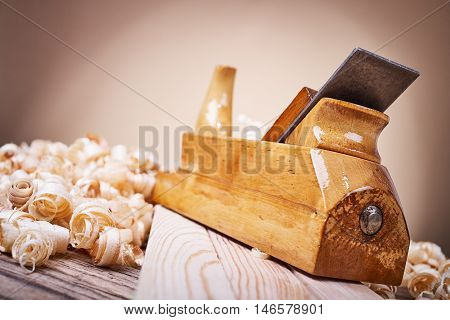 Wooden planer, natural building materials, woodwork and antique hand tools, carrying out carpentry, wood sawdust
