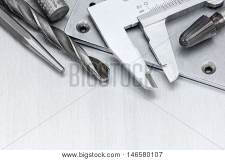 Tool Set Of Vernier Caliper And Drills For House Repair And Construction On Scratched Metal Backgrou