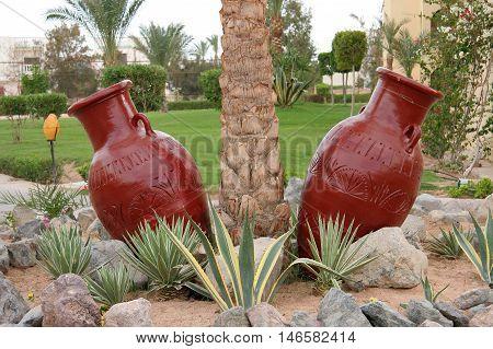 Two decorative design earthen jugs, Egypt, Hurghada