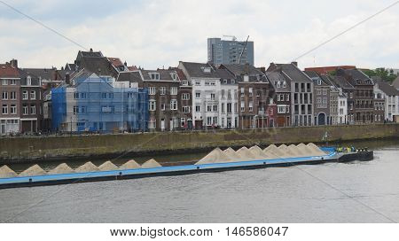 Barge carrying sand on River Maas in Maastricht Holland