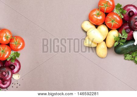 summer background with fresh vegetables on top