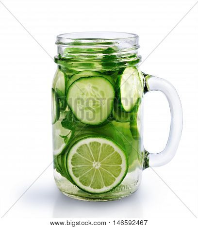 Detox water with cucumber and lime in a glass jar isolated over white
