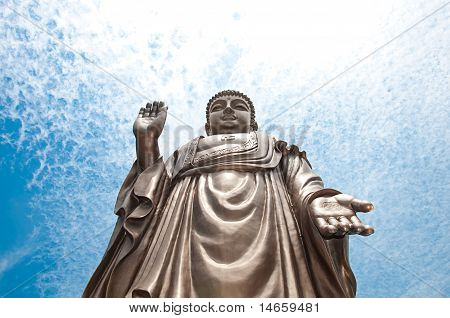 Buddha with blue sky.