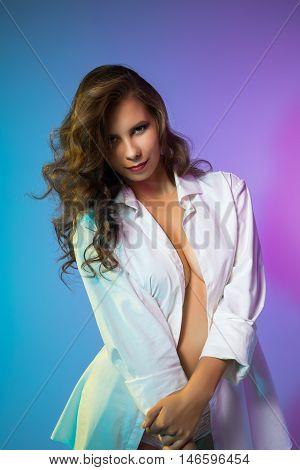 Photo of flirty girl posing in blouse over her naked body