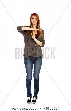 Teenage woman doing a break symbol