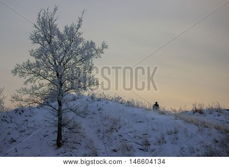 winter landscape lonely man sitting on montain