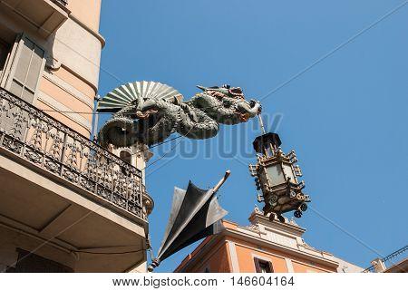 JUNE 14 2011 - BARCELONA SPAIN: Dragon sculpture on building facade La Rambla. Barcelona