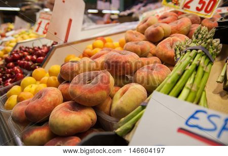 Flat peaches or  Donut peaches at market. Barcelona. Spain