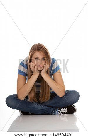 Teenage sad woman sitting on the floor