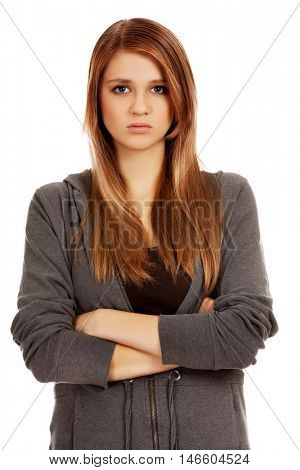 Worried teenage woman with folded arms